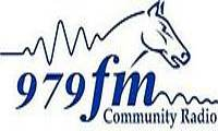 979 FM
